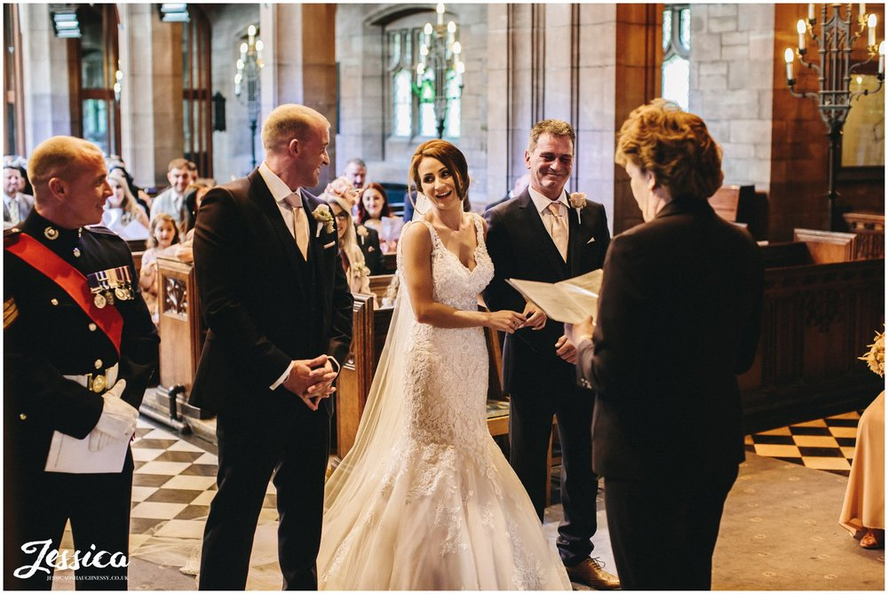 bride laughs during the wirral wedding ceremony