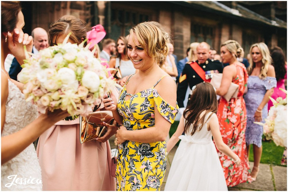 wedding guests wear bright colours for the summer wedding