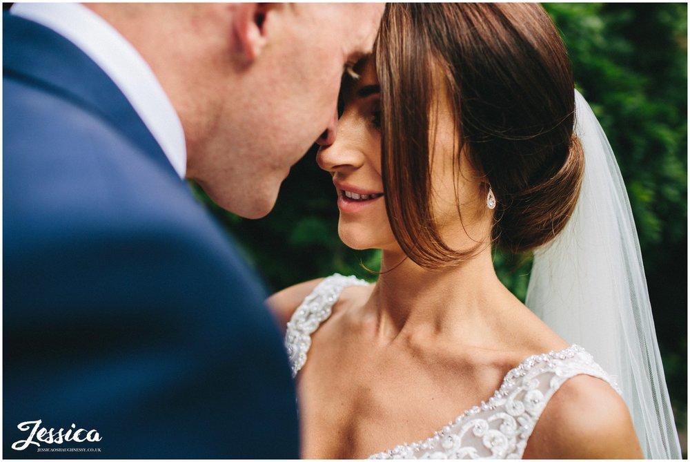close up the bride & groom embracing