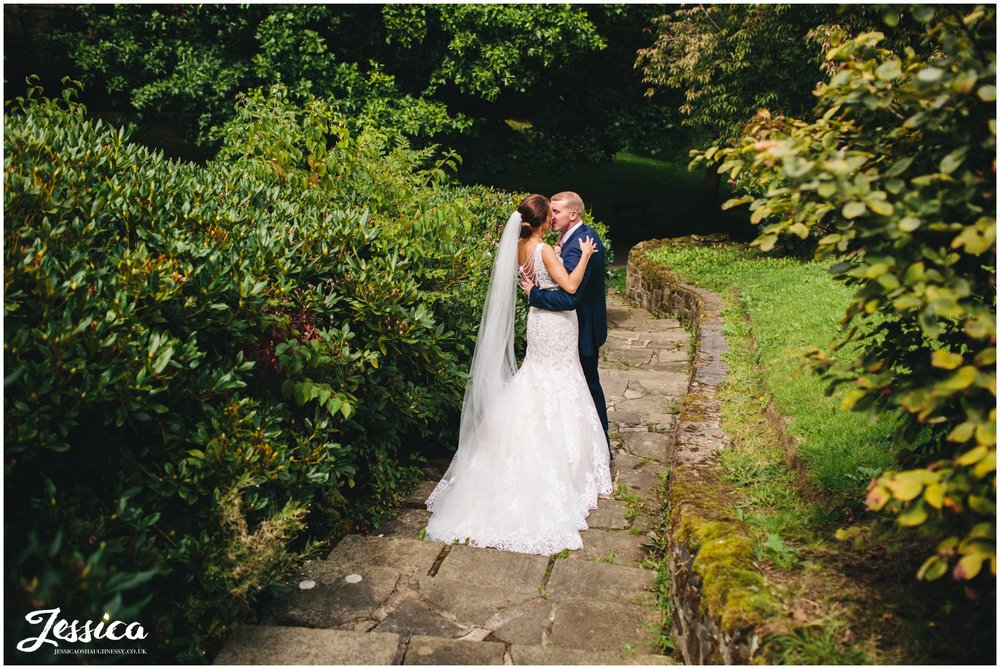 bride & groom kiss on the steps in port sunlight on their wirral wedding