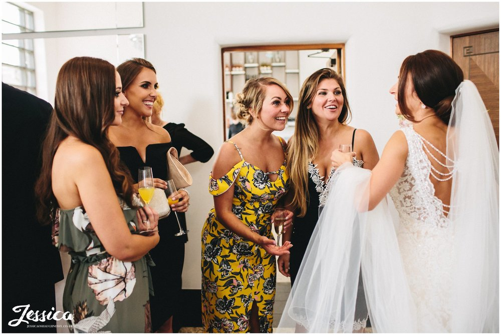 brides friends admire her inside the hotel