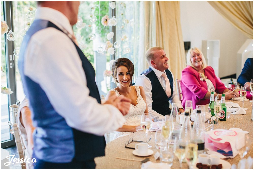 top table laughing during the father of the brides speech