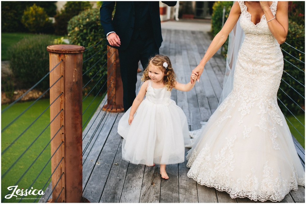 daughter holds the brides hand