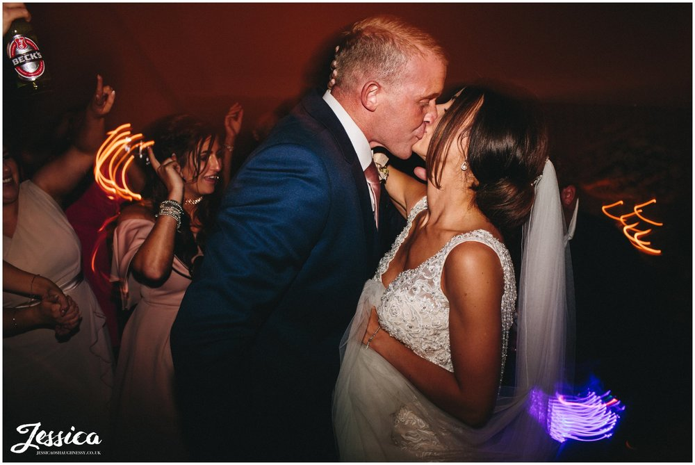 newly wed's share a kiss during their first dance