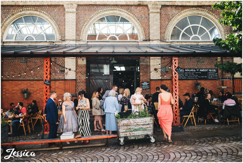 photograph of wedding guests outside altrincham market