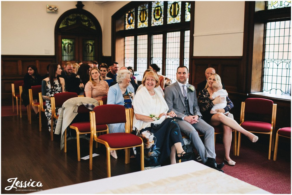 guests laughing in altrincham town hall
