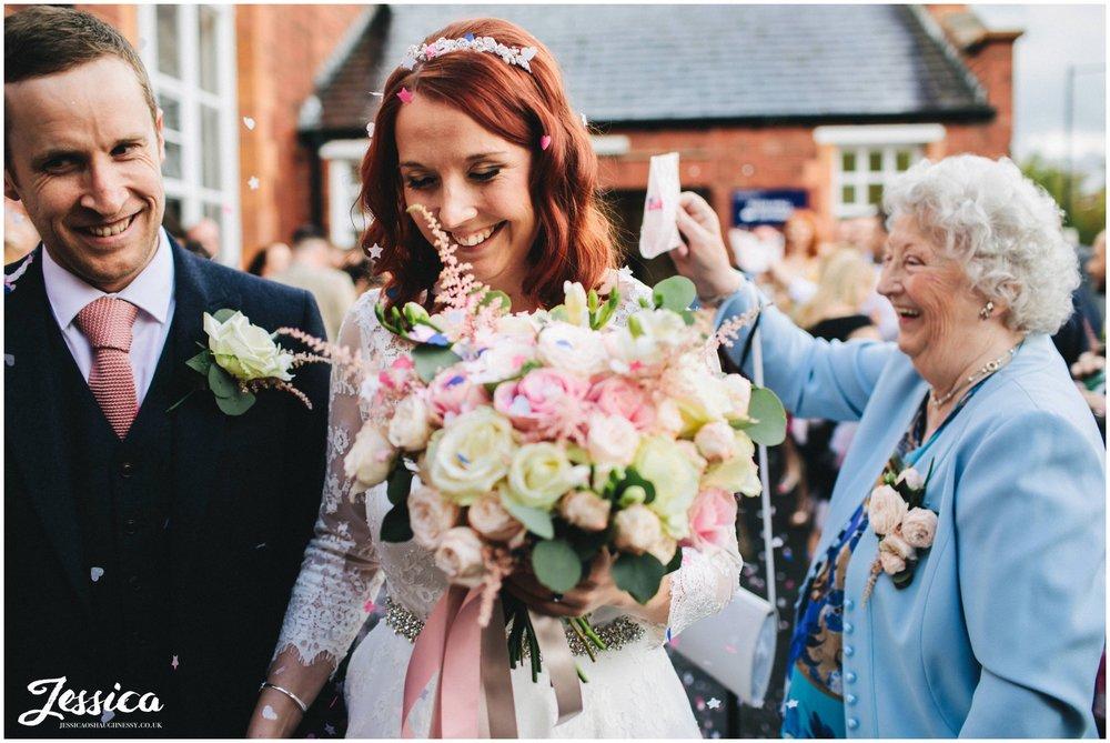grandma pours confetti over the bride at a manchester wedding