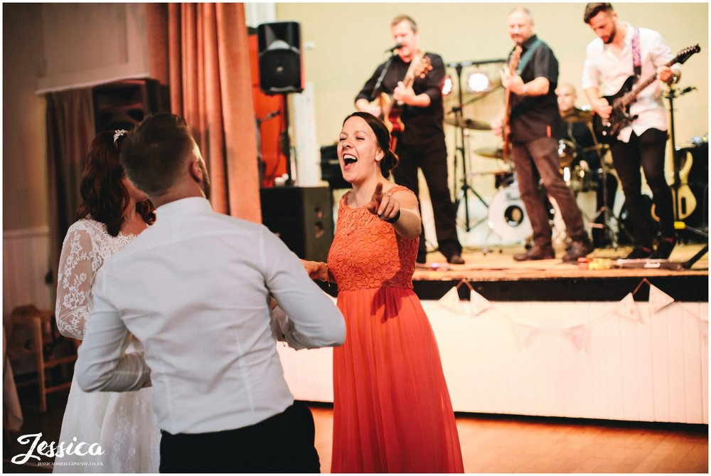wedding guests dance as the band plays