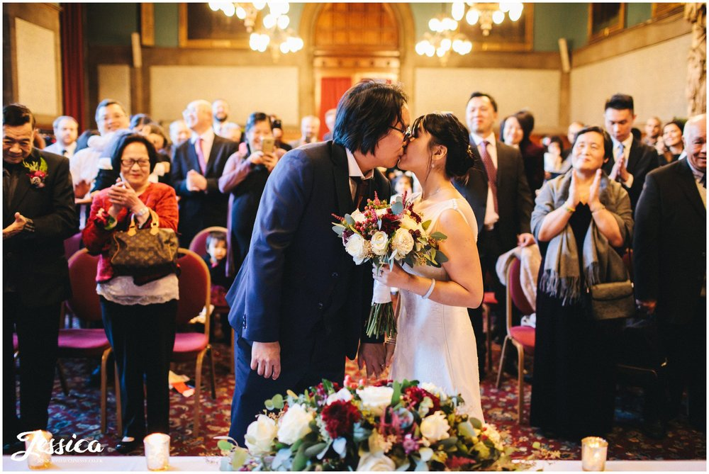 newly wed's share their first kiss