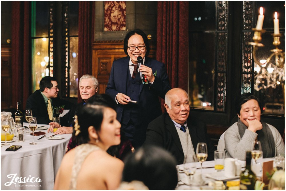 groom gives his speech at his winter wedding in manchester