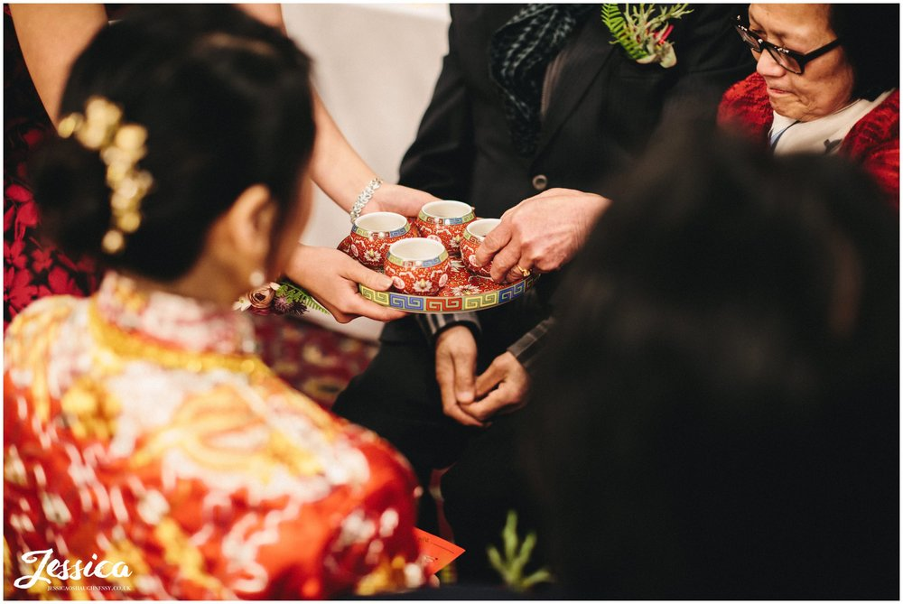 guests take tea during the traditional chinese ceremony