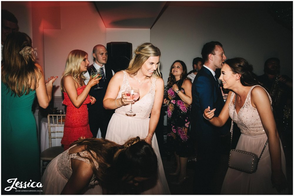 bridesmaid laughing on the dancefloor during the wedding reception