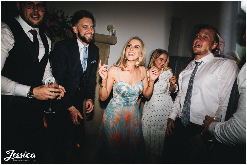 wedding guests start a dance off on the dancefloor