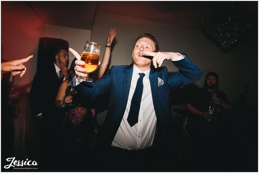 wedding guest dances at tyn dwr hall, a north wales wedding venue