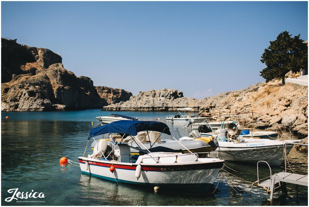 boats anchored along st paul's bay in rhodes