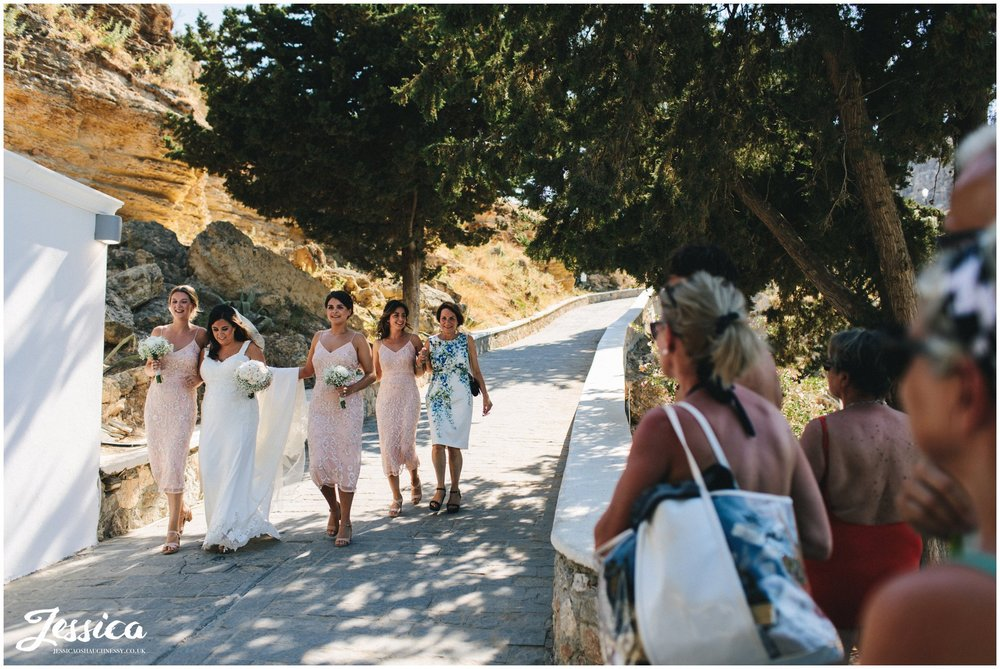 the public watch the bride walk down to make her entrance