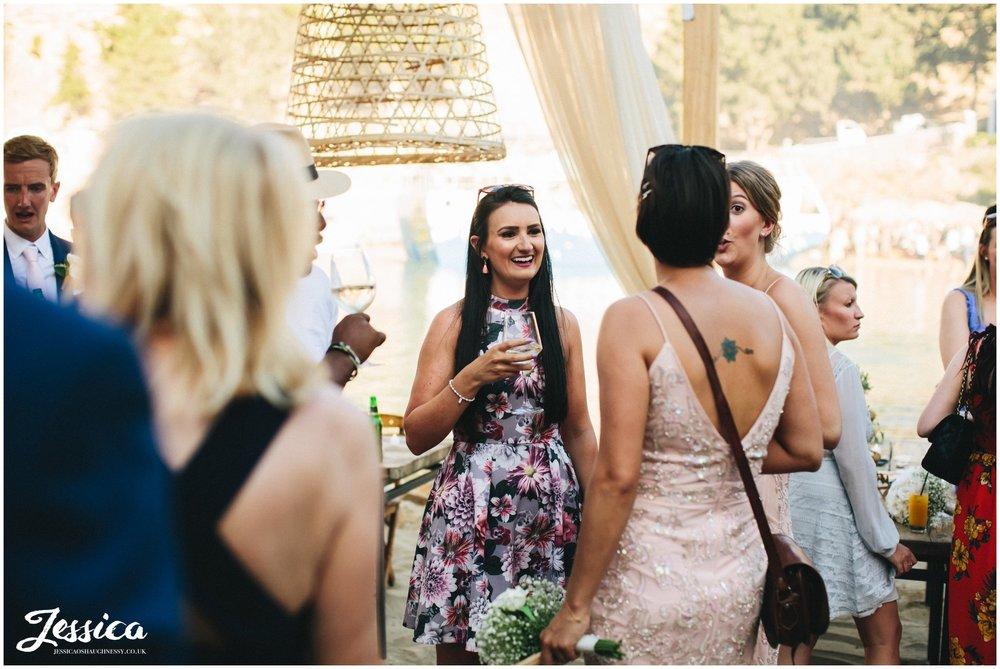 wedding guests enjoy welcome drinks at Tambakio Restaurant in rhodes