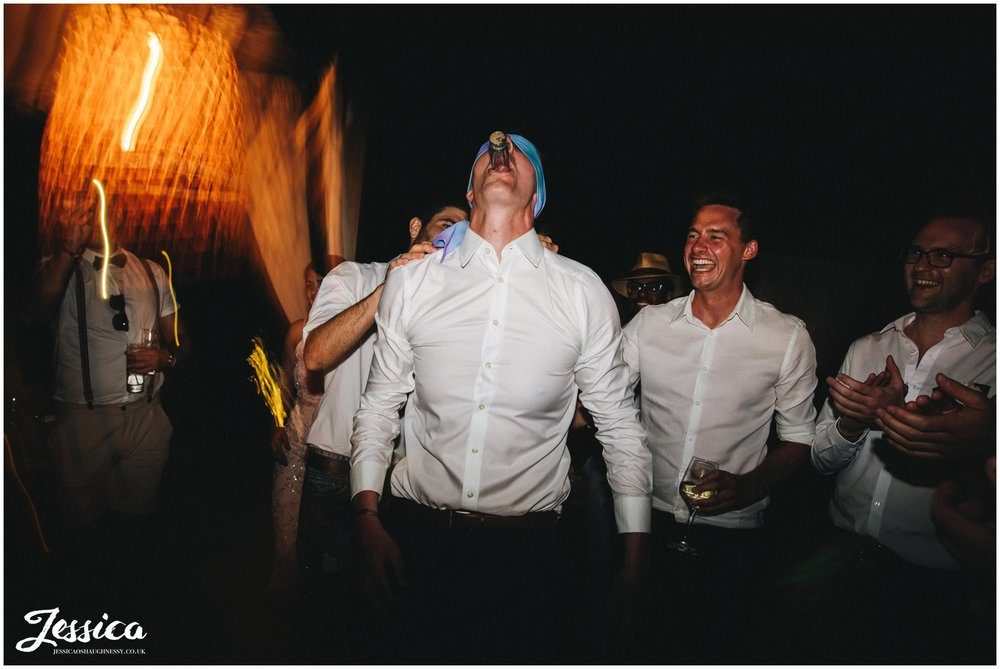 groom downs his shot blindfolded
