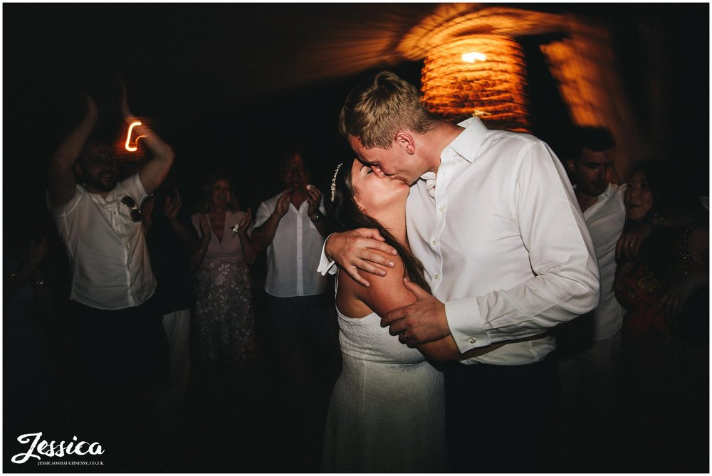 newly wed's kiss on the dancefloor at their st paul's bay wedding in greece