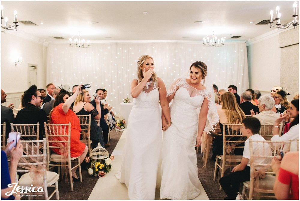 the brides walk down the aisle as wife & wife