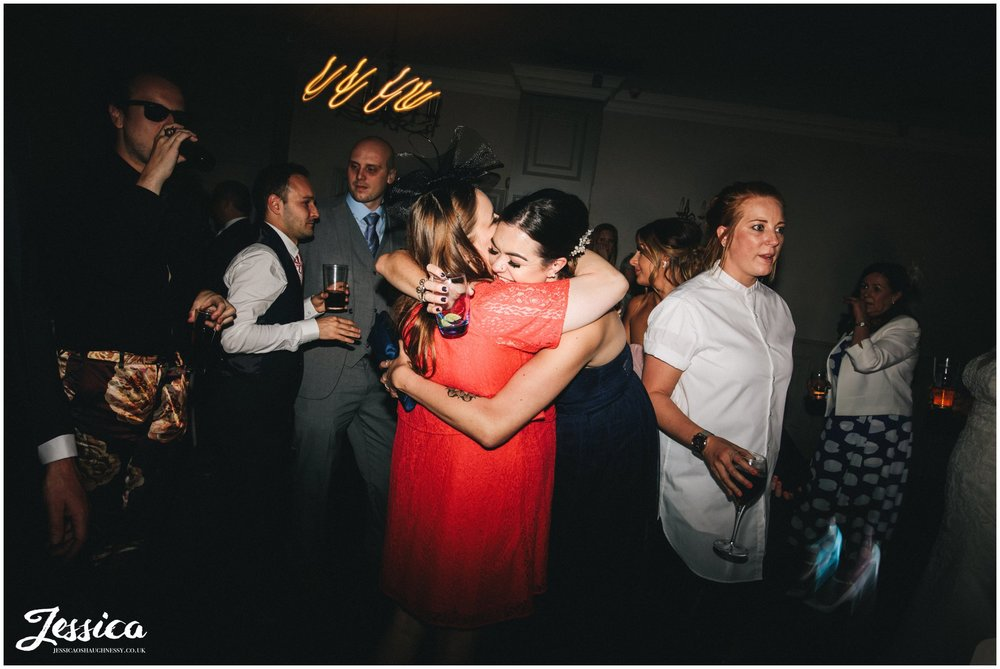 guests hug on the dancefloor at a cheshire wedding