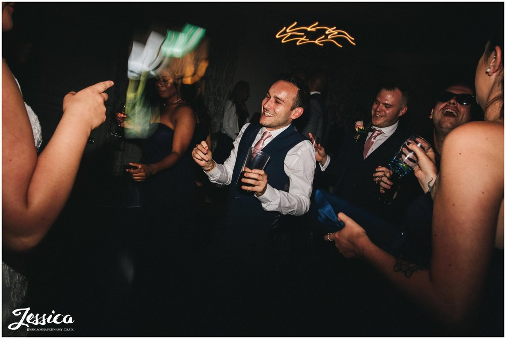 bridesmen dance at the wedding reception