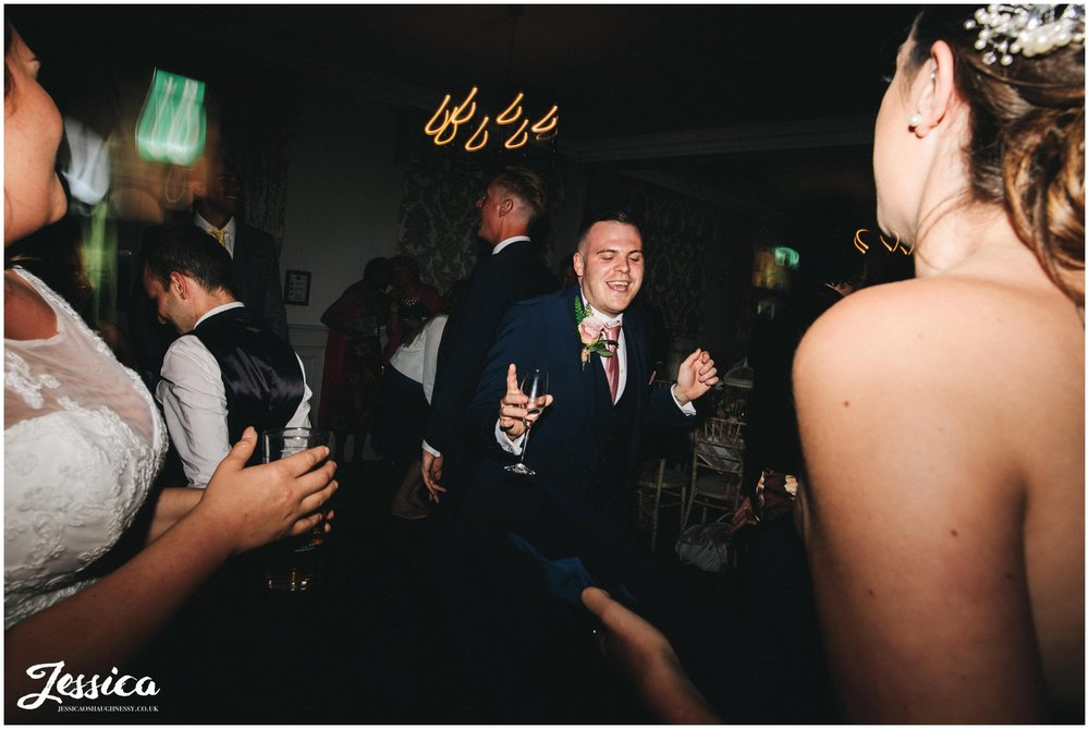 friends of the brides take to the dancefloor to celebrate the couple