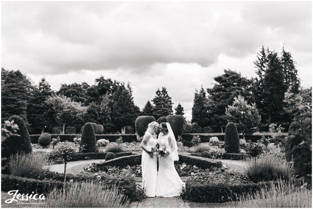 The bride's kiss in Mottram Halls gardens