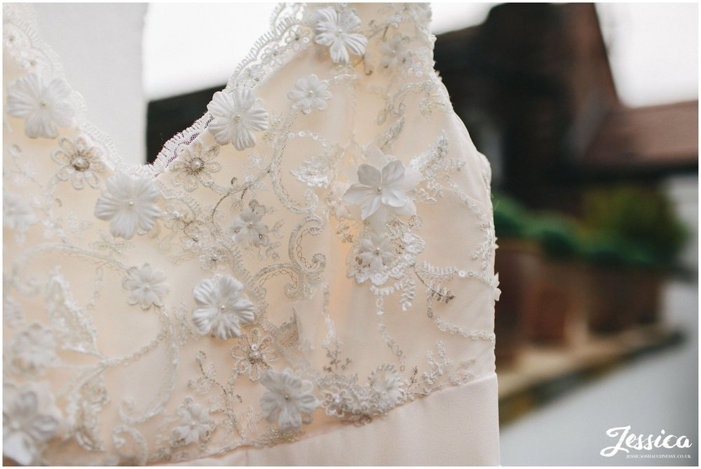 close up of the detail on the wedding dress