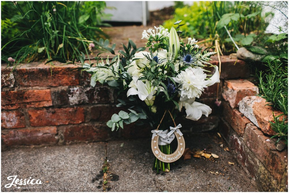 the brides bouquet sits with a lucky horseshoe attached