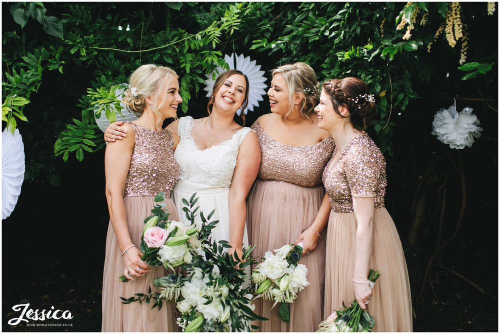 the bride laughs with her bridesmaids at belle epoque in cheshire