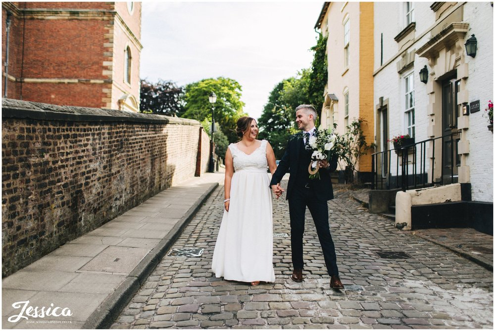 newly wed's walk down quaint cobbled streets of knutsford