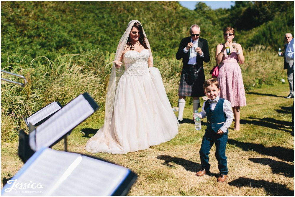 the newly wed's son dances to the brass band in north wales