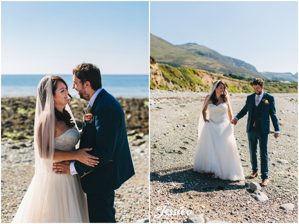 the couple enjoy the sun on Caernarfon bay at their bach wen wedding
