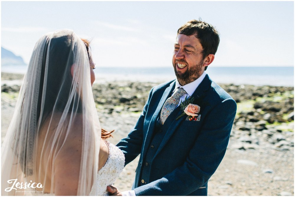 the groom laughs with his bride on their north wales wedding day