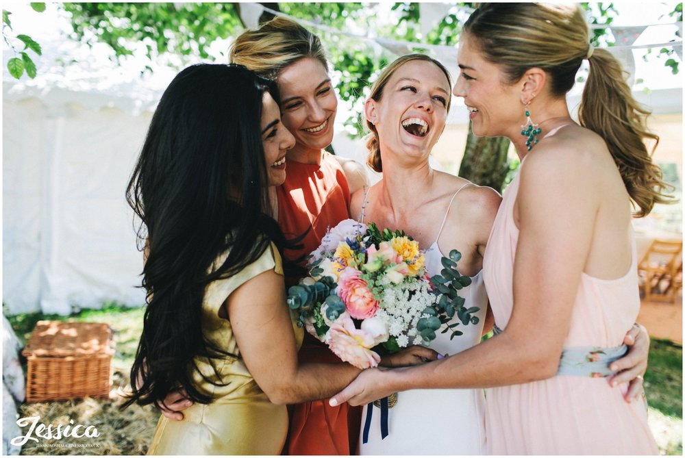 bride laughs with her bridesmaids at hafod farm in north wales