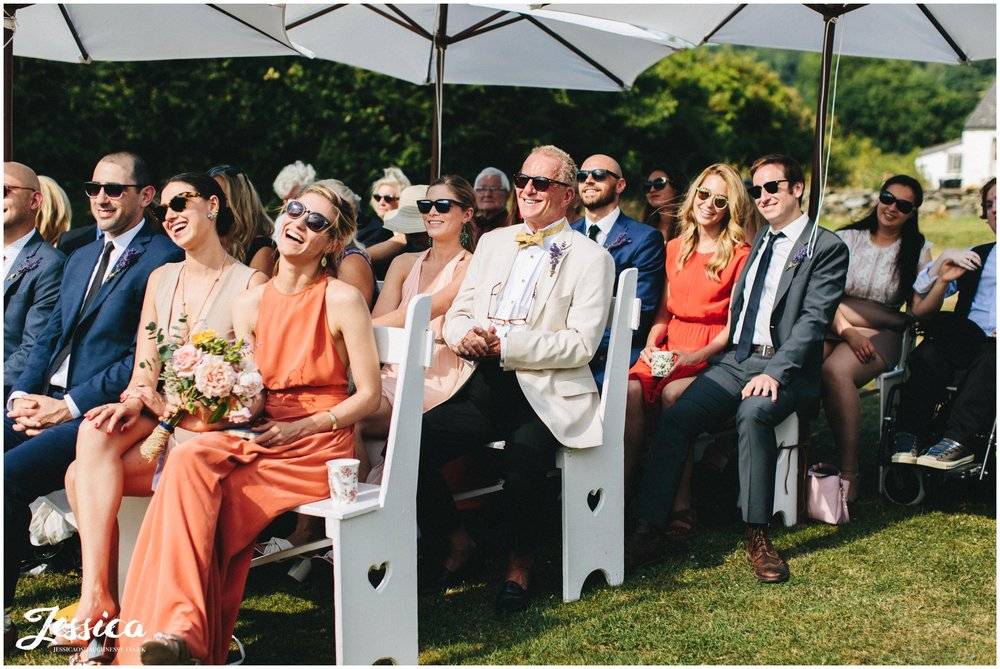 wedding guests laugh during funny moment