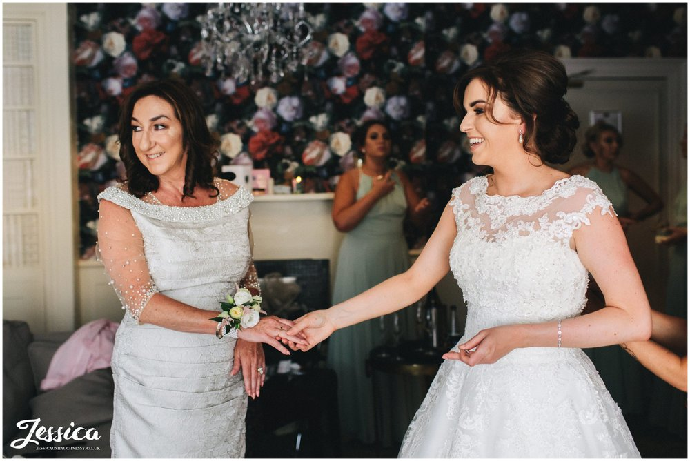 bride & her mother on the morning of the wedding at bartle hall