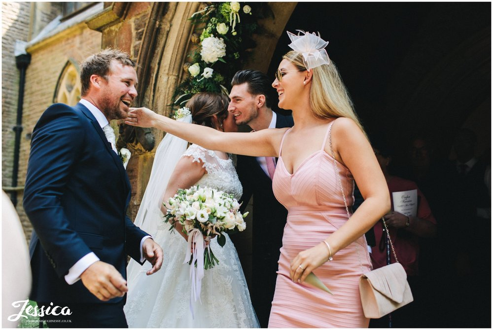 wedding guest hugs the groom after this ceremony