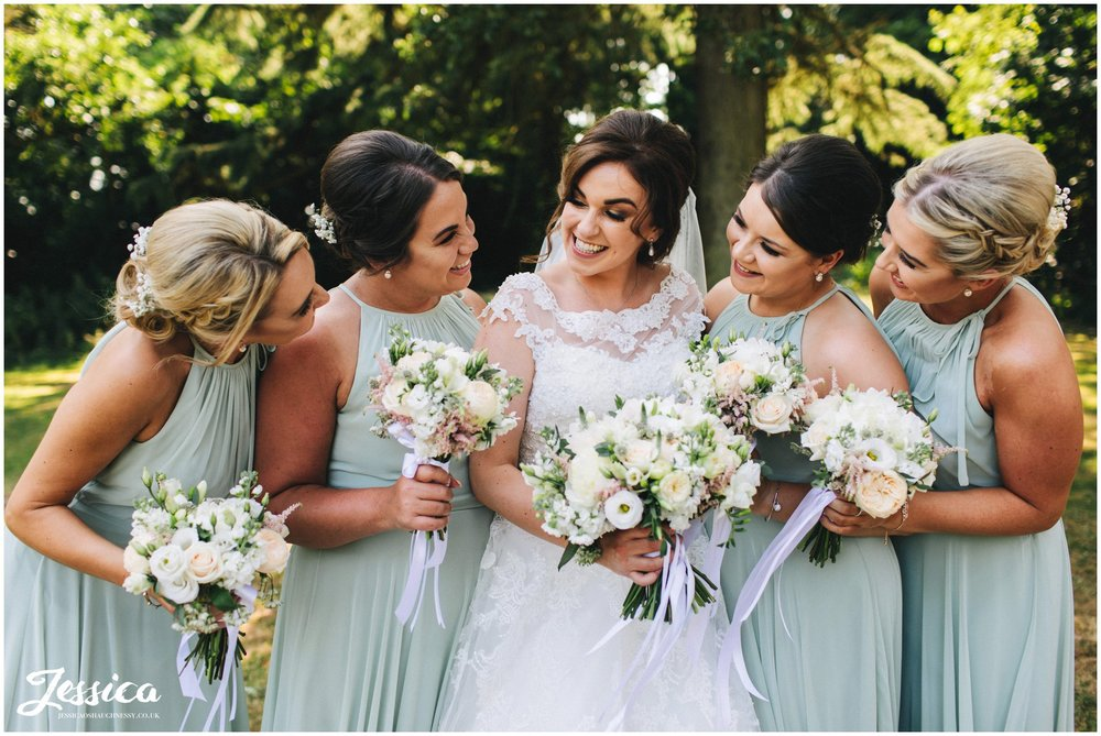 bride & her bridesmaids laughing together