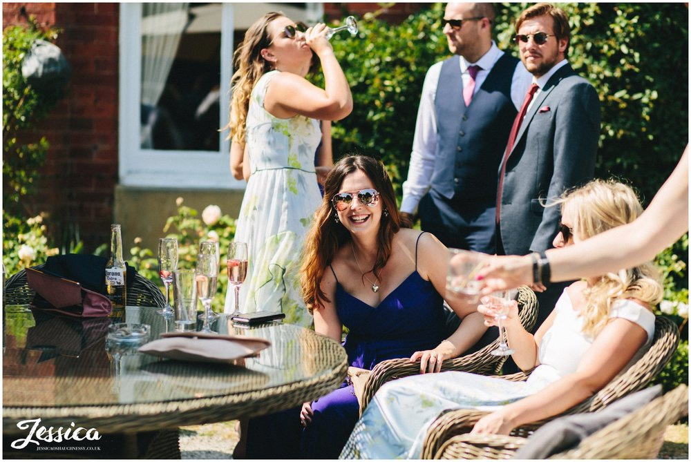 guest laughs sat on bartle hall's terrace