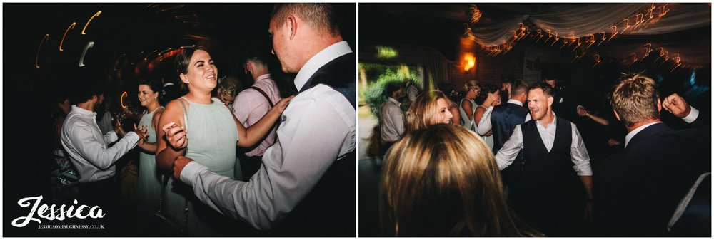 friends of the happy couple celebrate on the dancefloor