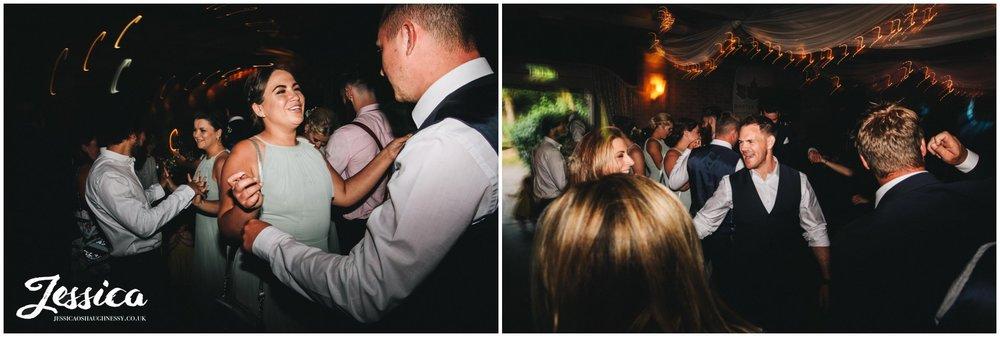friends of the happy couple celebrate on the dancefloor