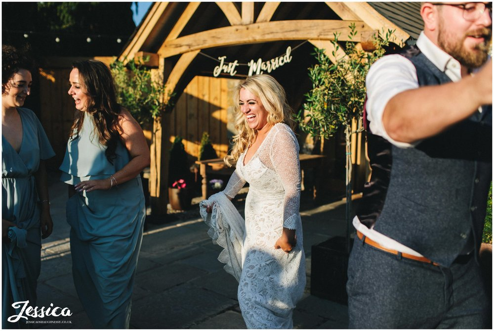 bride dances in the sun outside her north wales wedding venue