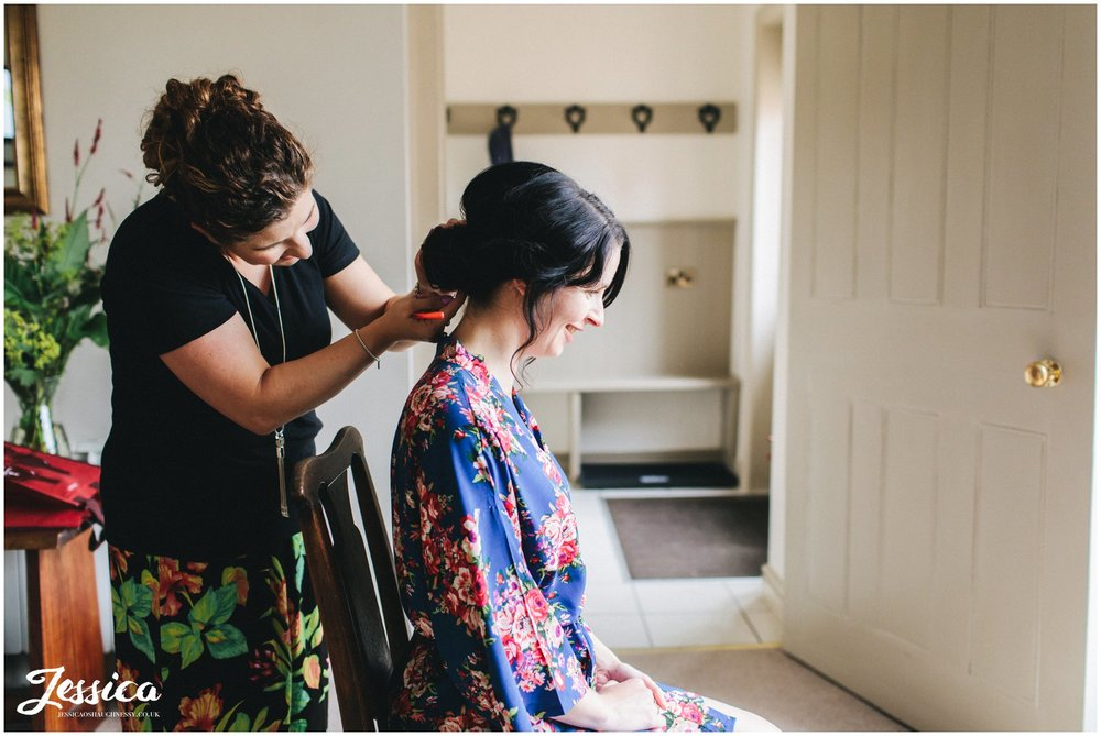 bridesmaid gets her hair done at combermere abbey