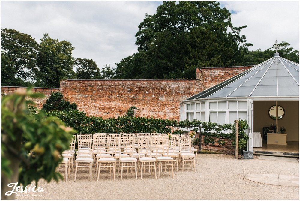combermere abbey's glasshouse set up for an outside ceremony