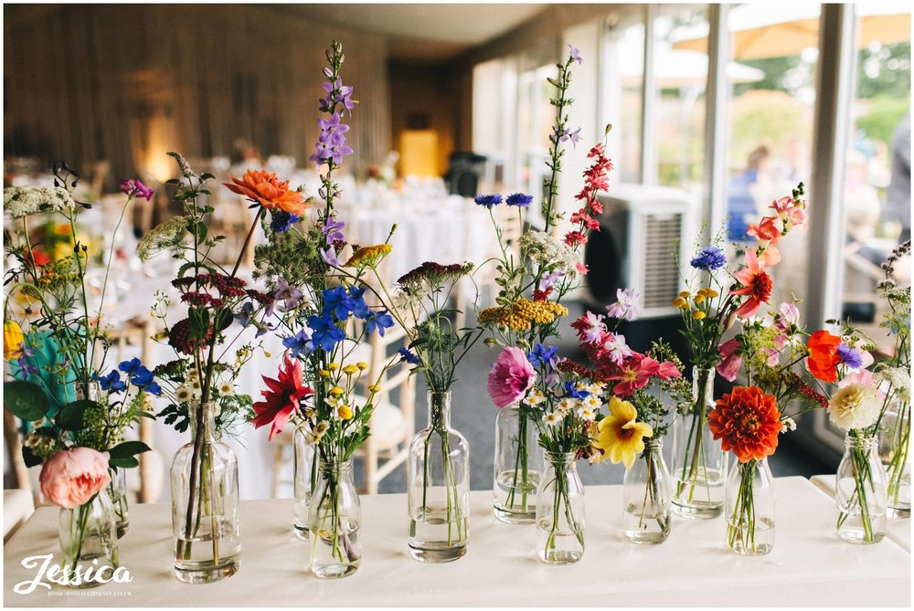 wildflowers in glass jars & bottles