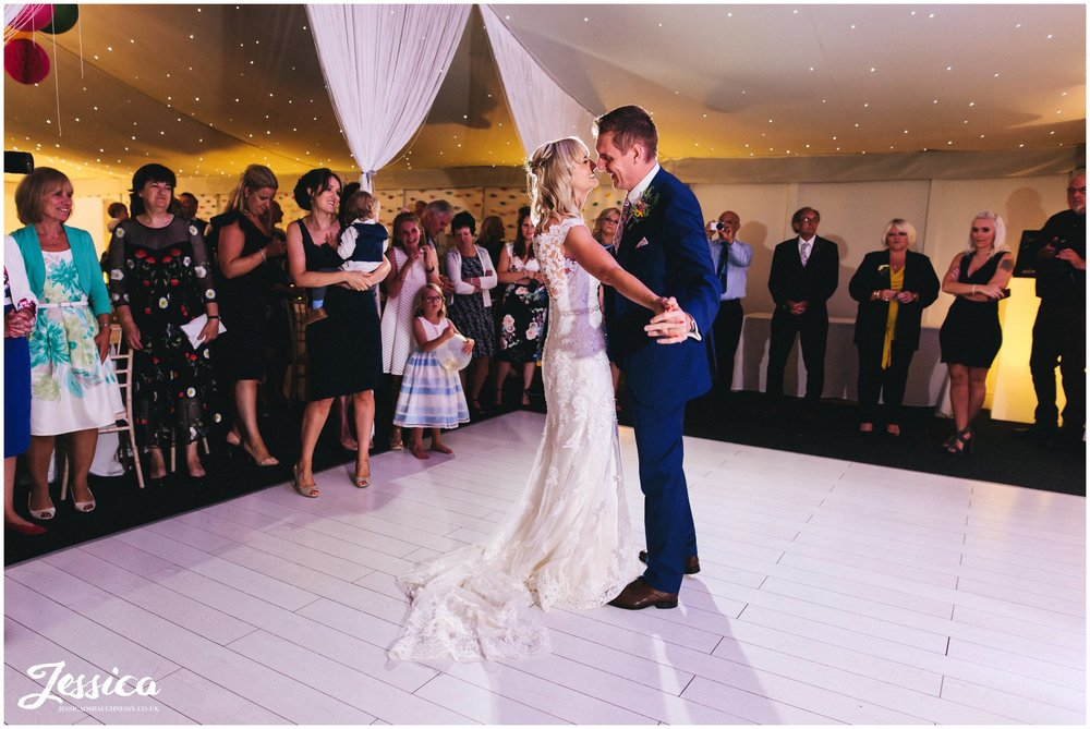 the couple share their first dance at combermere abbey