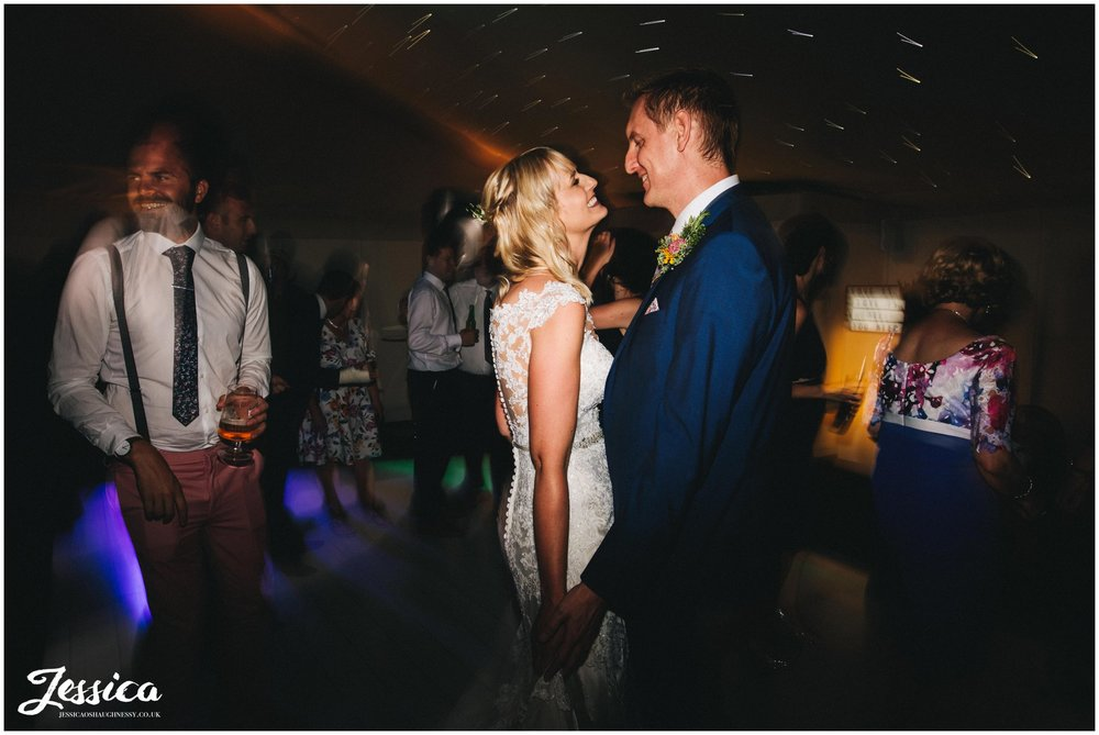 bride & groom dance on the dancefloor