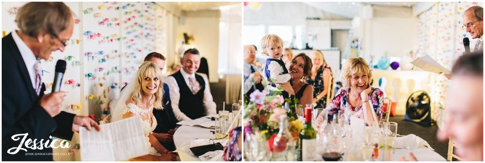 the top table laughs during the father of the brides speech